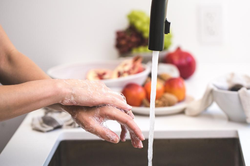 photo of person washing hands